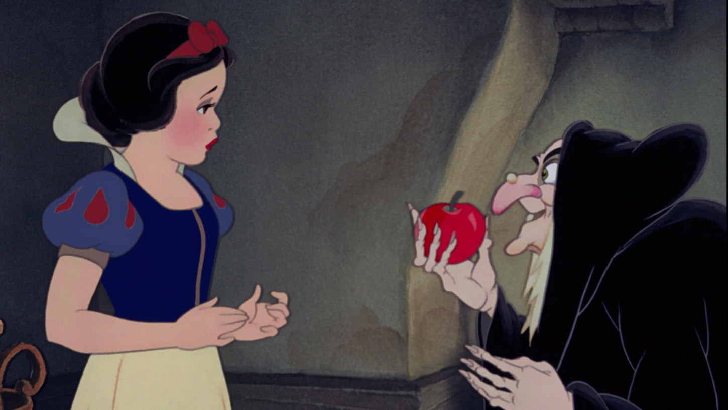 A witch offering a poison apple